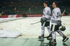 Mackenzie MacEachern, 15, and Thomas Ebbing, walk off the rink following the Great Lakes Invitational consolation game Dec. 28, 2013, at Comerica Park in Detroit. The Spartans defeated the Wolverines, 3-0. Danyelle Morrow/The State News