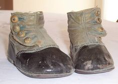 Antique child's high-top button shoes