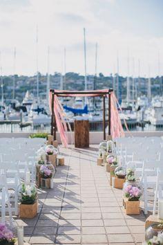marina wedding ceremony, photo by Rad + In Love http://ruffledblog.com/kona-kai-resort-wedding #weddingceremony #ceremonies