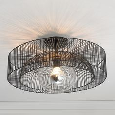 Wire Wheel Semi-Flush Ceiling Light A simple wire spoke wheel creates this modern industrial semi-flush ceiling light. The clear glass center globe adds a modern element to this industrial style light.