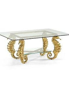 Enjoy the beauty of the sea in your home with the Seahorse Coffee Table that features four intricately detailed legs and a beveled glass tabletop and shelf.