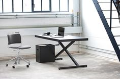 Adjustable height table desk with cable routing.