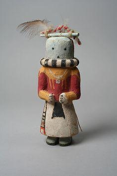 Hopi Katsina doll with neck ornament, 20th century, United States, Arizona. Medium: Wood, paint, cloth, feathers. The Metropolitan Museum of Art.