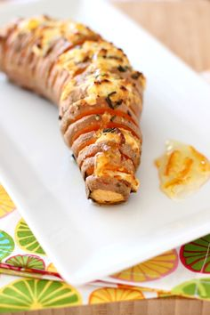 Hasselback Sweet Potatoes with Orange Rosemary Butter & Goat Cheese
