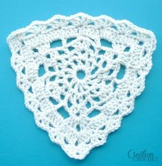 Dress your crochet projects with this Lace Triangle Motif. This free crochet pattern makes a lovely motif that would look fantastic as an adornment to your favorite crochet crafts. Switch to cotton yarn to make this into a beautiful trivet. Crochet Triangle Pattern, Granny Square Crochet Pattern, Crochet Blocks, Crochet Squares, Crochet Motif, Crochet Flowers, Crochet Lace, Crochet Bunting Pattern, Crochet Granny