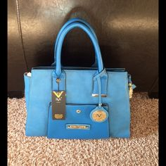 """New w/tags Versace blue satchel New w/tags Versace blueberry Abundantia satchel. Versace 1969 Abbigliamento Sportivo SRL Milano Italia. Length 14.5"""", width 6"""", Height 11"""", with handles 16"""" high. Comes with dust bag Versace Bags Satchels"""