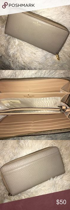 Kate Spade Wallet AUTHENTIC.  Zipper wallet.  Minor stain on bottom corner from hand sanitizer that spilled in my bag and dried up 😑  other than that though still in good condition! kate spade Bags Wallets