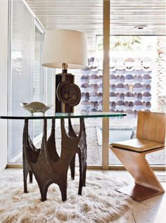 William Coddy in Palm Spring, table by Paul Evans, lamp by Roger Capron and Gerrit Rietfeld's chair