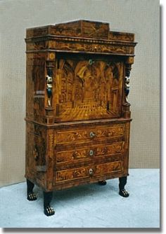 A CONTINENTAL WALNUT ENGRAVED AND MARQUETRY SECRETAIRE A ABATTANT - CIRCA 1800