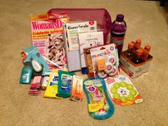 New Mom Gift includes: Magazine, Changing pad, Lingerie bag (i.e. toys, socks), Cliff Bars, Munchkin Fresheners, Water Bottle, Wine (single glass: nursing moms probably won't finish a bottle), Teether, Razors, Eye roller (LOVE these!), Clorox Wipes, Wet Ones, Lotion, Nail File, Nail Clipper  Deodorant. All in a functional container.