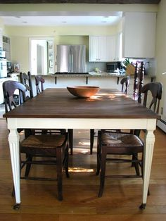 exactly how i want to paint my dining room table - darker stain on top, light paint on bottom distressed a bit!