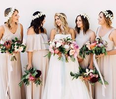 Bridesmaids with tropical bouquets and flower crowns wearing @showmeyourmumu  See more from this Tropical Boho wedding #onGWS today {link in profile}  photography: @elysewhall // venue: @thecasinosc // wedding planning: @samanthalouisemoments // event design: @tamerabeardsley + @ellistracy // florals: @thedaintylionfloralco // wedding dress: @verawanggang from @davidsbridal // paper goods: @bettylupaperie // tabletop + furniture rentals: @adorefolklore #weddingideas #bridesmaids