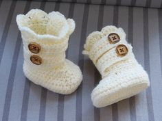 Crocheted booties are what Mr. C can wear right now over his little cast, it would be so nice to be able to make my own for him, these might be a little too girly though...