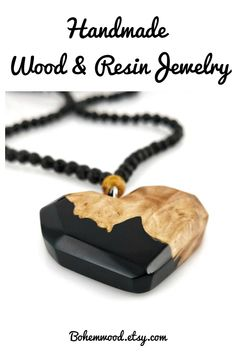 This unique heart necklace necklace is handmade from wood and black epoxy resin. Click to check it out!
