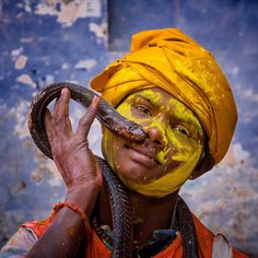 A SNAKE & A SMILE:  Your Shot photographer Avishek Mazumder captured this portrait of a boy and his snake at a Holi festival in Vrindabon, India.