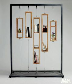 """A remanier pour faire une """"partition"""" sur roulettes The lack of space for books is so astonishing that I cannot in good conscience call it a bookshelf, but it is an innovative and attractive decoration. Perhaps a room divider or window screen of sorts."""