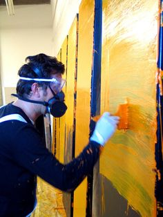 Artist: Clem Crosby painting Auditorium cladding