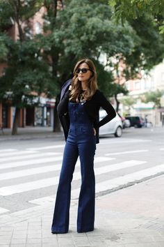 Denim overalls with flare bottoms are so cute when paired with wedges or boots.