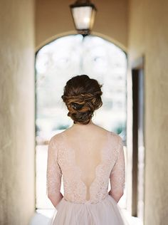 An elegant chignon from this peaceful blush bridal photo session. Great inspiration for the modern, minimalist bride.  #bridalportraits  #weddinghairstylesforlonghair  #elegantbridalportraits
