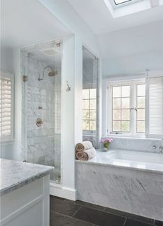 """Dipt Box """"Luxe"""" Bathroom by Sample Dipt Design by Unknown (Have info about the designer? Drop us a hint via text chat.) Light-colored marble on the walls and counters creates a light and airy space in the bathroom. The pale blue walls mimic the color of a clear sky and almost blend in with the m"""