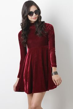 Make everyone else swoon over you in this Velvet Dream Dress. This dress features smooth velvet main, short turtleneck, long sleeves, and A-line skirt.