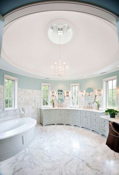 Stunning, romantic round tower bathroom in robin's egg blue and marble - a room fit for a princess