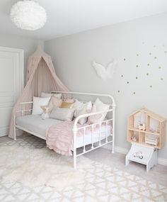 Pink and gold girls room with canopy