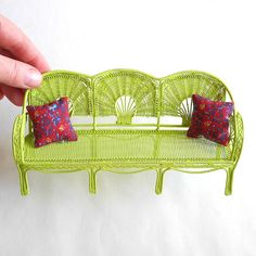 I decorate my window sills with miniature outdoor furniture.