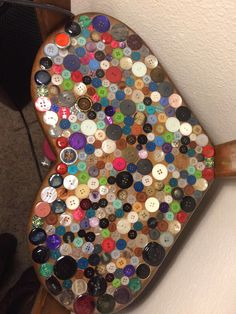 Table with buttons glued on and sealed with pour on acrylic finish.