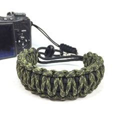 Olive Drab and Moss Camo DSLR Camera safety strap. Easy to wear, tangle free, super strong, and very light. Want one in your favorite colors, or team colors? Hit me up. www.stupidstraps.com #papabearshouse #stupidstraps #straps #camerastrap #strap #camera #550 #strong #olive #olivedrab #moss #camo #camouflage #dslr #safetystrap #safety #photography #custom #handmade #nikon #madetoorder #canon #sony #photographer #black