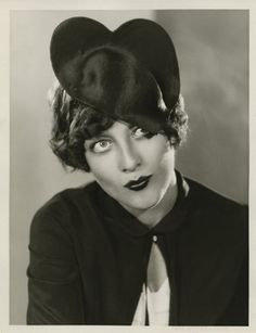 Joan Crawford wearing a heart hat,1920s.