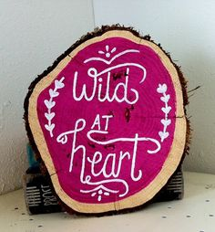 Wood slice art with the quote Wild at Heart by RNTaylorStudios
