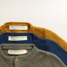 Baby cardigans in mustard, navy and grey wool
