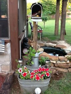 Decorative planter with old mailbox centerpiece for storing garden tools. - Hometalk