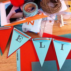 Eli's first birthday party prep. Orange, red and teal theme.