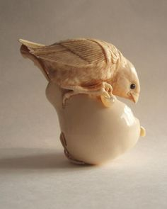 Netsuke of a young bird feeding on a pear (Image Two).