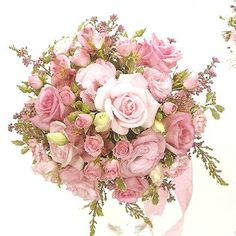 Pink roses, alstro, lisianthus, mini carns, and wax flower@Chris Myall Nikkie Roth