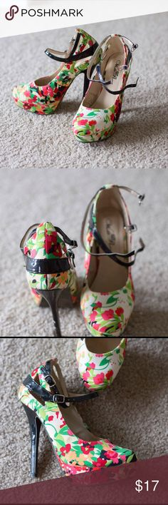Floral heels Floral printed heels with an ankle strap and foot strap. Some scuffs and scrapes to the heels, and stains on the fabric as shown in the third photo (they blend into the pattern well) size 6.5 but could fit a small size 7 Wild Rose Shoes Heels