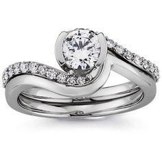 Twirl diamond engagement ring with matching wedding band.