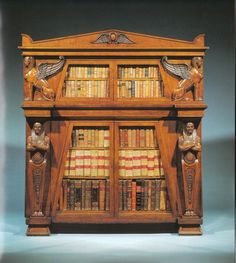 Wow. An amazing Egyptian Revival cabinet in the Carlton Hobbs collection. The carving is extraordinary.