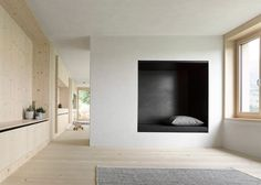 Interior shot of a wooden residence located in Austria's picturesque Bregenz Forest.