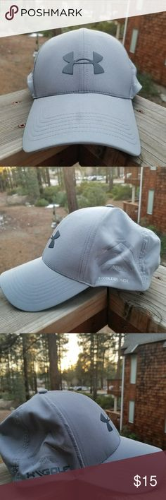 Under Armour Grey Under Armour Golf hat. Velcro strapnfor adjustable fitting to perfection. There is a dark spot on the brim of the hat, also on the inside brim it has typical hat wear. Under Armour Accessories Hats