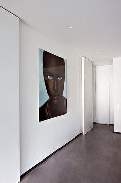 Art installation inside the white Perke House in Belgium by architect Bruno Erpicum _