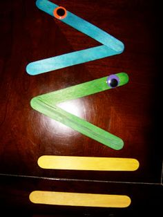 popsicle stick greater than/less than...so cute!