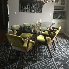 Impress your guests with the vintage flair of this spacious and sleek dining table. Glass Dining Table, Dining Chairs, Dining Rooms, Mismatched Chairs, Dining Chandelier, Custom Made Furniture, Vintage Kitchen, Home Accessories, Room Decor