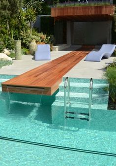 pool with wooden diving board/waterfall