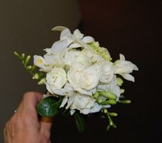 Freesia and white spray rose nosegay.  I love this one too.  :)