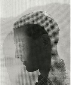 Boy in profile behind drapes, ca. 1932  Herbert List  German, 1903-1975.  I love the manner in which the back of his hair has been cut, with the high, smooth, curving nape.