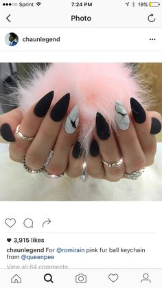 Matte black and marble stiletto nails.