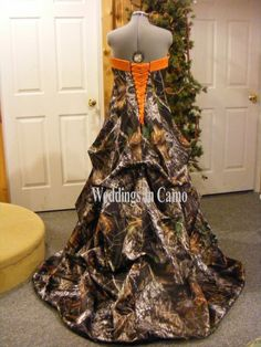Our best selling princess camo wedding dress with pickups and corset back. AVAILABLE in 14 colors, customized to your personality, in sizes 2-28, starting at $797.99 ***www.weddingsincamo.com